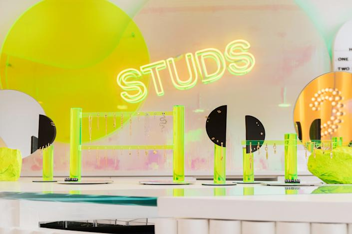 The design team ditched the typical earring display, instead creating sculptural neon acrylic objects for the Studs merchandise.