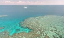 A general view of Broadhurst Reef and a research vessel during the second field trial at Broadhurst Reef on the Great Barrier Reef