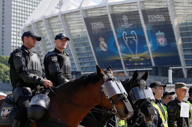 Members of the Ukrainian National Police take part in a security exercise during preparations for the Champions League final between Real Madrid and Liverpool outside the NSC Olympic stadium in Kiev, Ukraine May 15, 2018. REUTERS/Valentyn Ogirenko