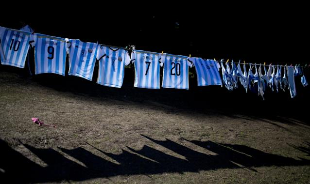 10ThingstoSeeSports - Argentina's national soccer team T-shirts hang for sale outside the Argentine Soccer Association before the team heads the airport in Buenos Aires, Argentina, Monday, June 9, 2014. Argentina's team is leaving Monday to compete in the Brazil's 2014 soccer Word Cup. (AP Photo/Natacha Pisarenko, File)