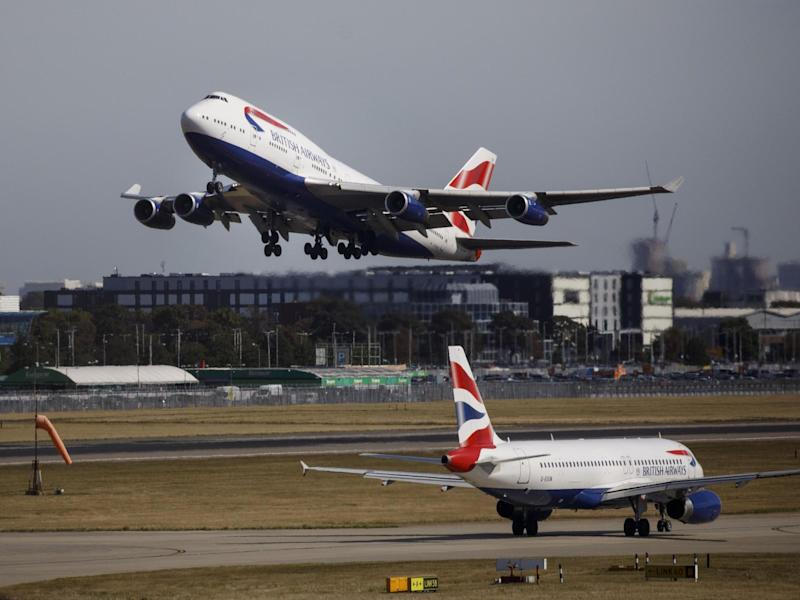 A British Airways airplane takes off from the runway at Heathrow Airport: Tolga Akmen/AFP via Getty Images