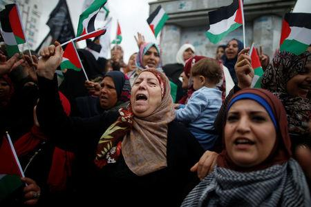 Palestinian women shout slogans during a protest against the U.S. intention to move its embassy to Jerusalem and to recognize the city of Jerusalem as the capital of Israel, in Gaza City