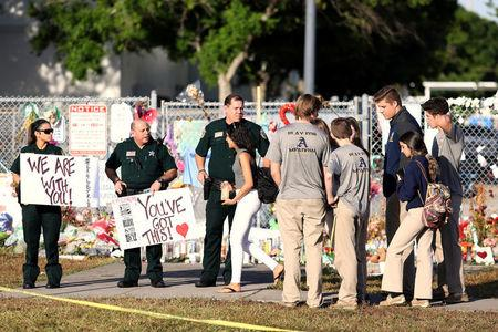 Florida governor signs gun restrictions three weeks after attack