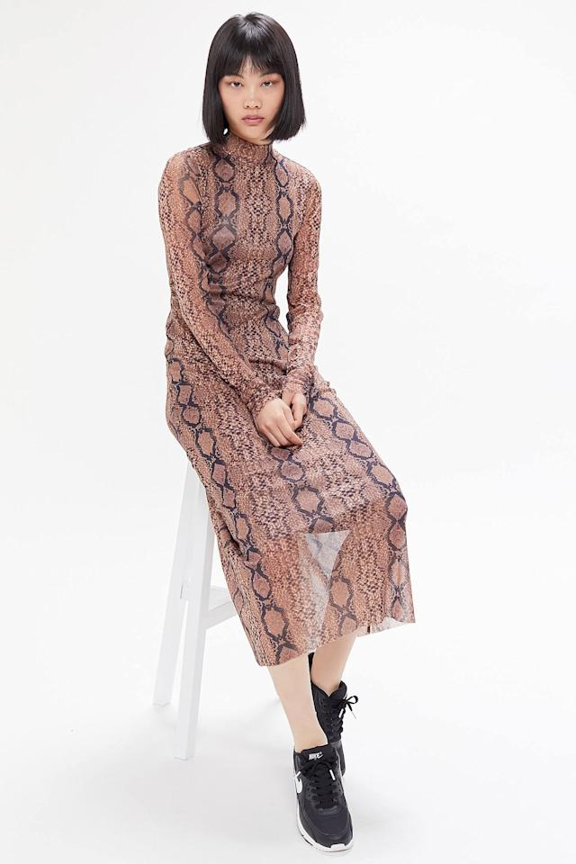 "<p>Make a statement in this cool <a href=""https://www.popsugar.com/buy/UO-Siren-Snake-Print-Mesh-Maxi-Dress-478973?p_name=UO%20Siren%20Snake%20Print%20Mesh%20Maxi%20Dress&retailer=urbanoutfitters.com&pid=478973&price=79&evar1=fab%3Auk&evar9=45821460&evar98=https%3A%2F%2Fwww.popsugar.com%2Ffashion%2Fphoto-gallery%2F45821460%2Fimage%2F46526345%2FUO-Siren-Snake-Print-Mesh-Maxi-Dress&list1=shopping%2Cfall%20fashion%2Cdresses%2Cleopard&prop13=api&pdata=1"" rel=""nofollow"" data-shoppable-link=""1"" target=""_blank"" class=""ga-track"" data-ga-category=""Related"" data-ga-label=""https://www.urbanoutfitters.com/shop/uo-siren-snake-print-mesh-maxi-dress?category=dresses&amp;color=029&amp;type=REGULAR"" data-ga-action=""In-Line Links"">UO Siren Snake Print Mesh Maxi Dress</a> ($79).</p>"