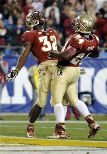 Florida State's James Wilder Jr. (32) celebrates his touchdown run with teammate Lonnie Pryor (24) during the first half of the ACC Championship college football game against Georgia Tech in Charlotte, N.C., Saturday, Dec. 1, 2012. (AP Photo/Mike McCarn)