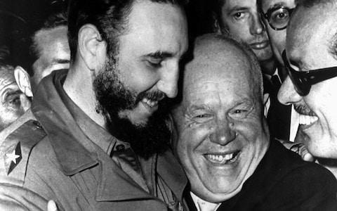 <span>Cuban president Fidel Castro, left, and Soviet leader Nikita Khrushchev hug at the United Nations in this late 1960 file photo</span> <span>Credit: AP </span>
