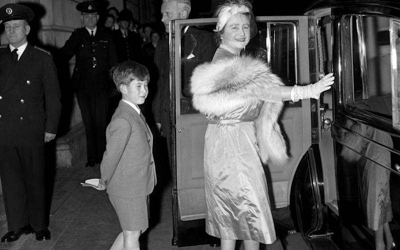 Prince Charles follows his grandmother, the Queen Mother, to their car after watching a matinee performance by the Bolshoi Theatre Ballet of Moscow at the Royal Opera House in October 1956 - PA Archive