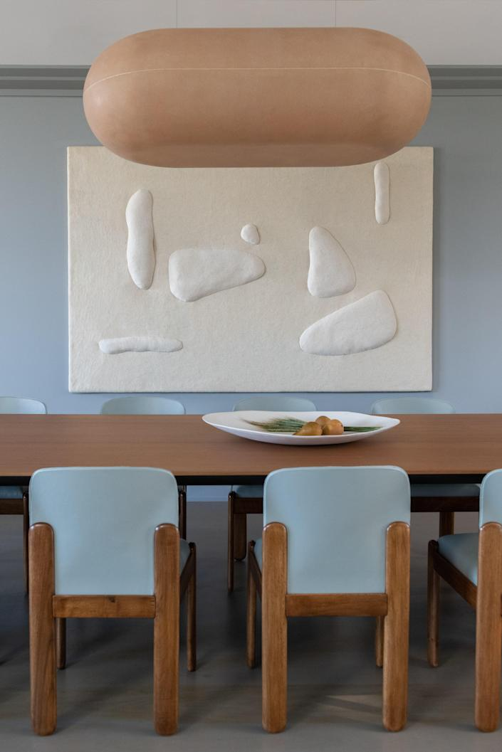 """Homan calls the raw fiberglass Puffball pendant by Faye Toogood """"visually thunderous, but soft."""" The Sheep Tapestry hanging on the wall, which is made of custom silk and merino wool felt from Northern California sheep, is by Studio Ahead."""