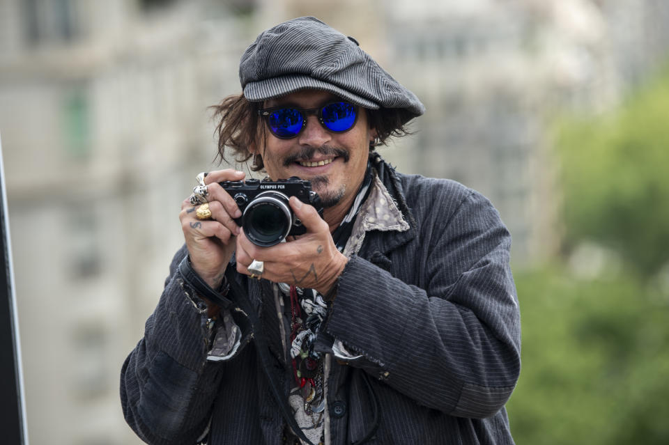 BARCELONA, SPAIN - APRIL 16: American actor Johnny Depp attends a photocall to present his latest movie