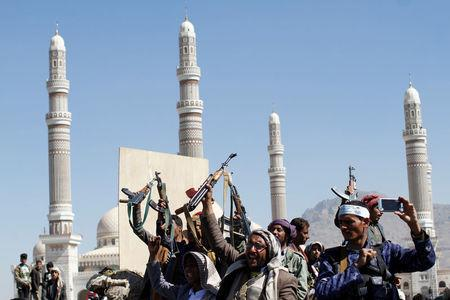 Houthi fighters attend the funeral of their fellow who were killed during the recent clashes in Sanaa