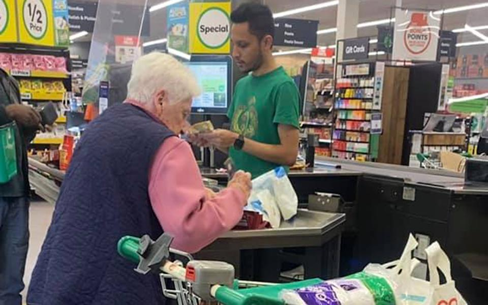 A dad has shared the moment he was touched by his teenage daughter's heartwarming act for an elderly lady at a Woolworths checkout. Source: Facebook