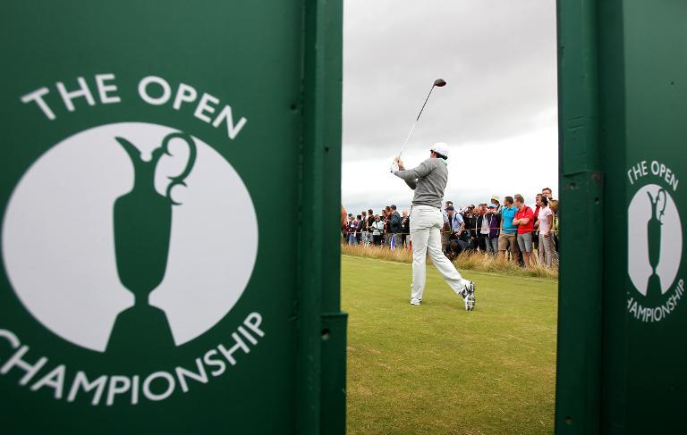 Northern Ireland's Rory McIlroy watches his drive during a practice round at Royal Liverpool Golf Course in Hoylake, north west England on July 16, 2014 ahead of The British Open Golf Championship