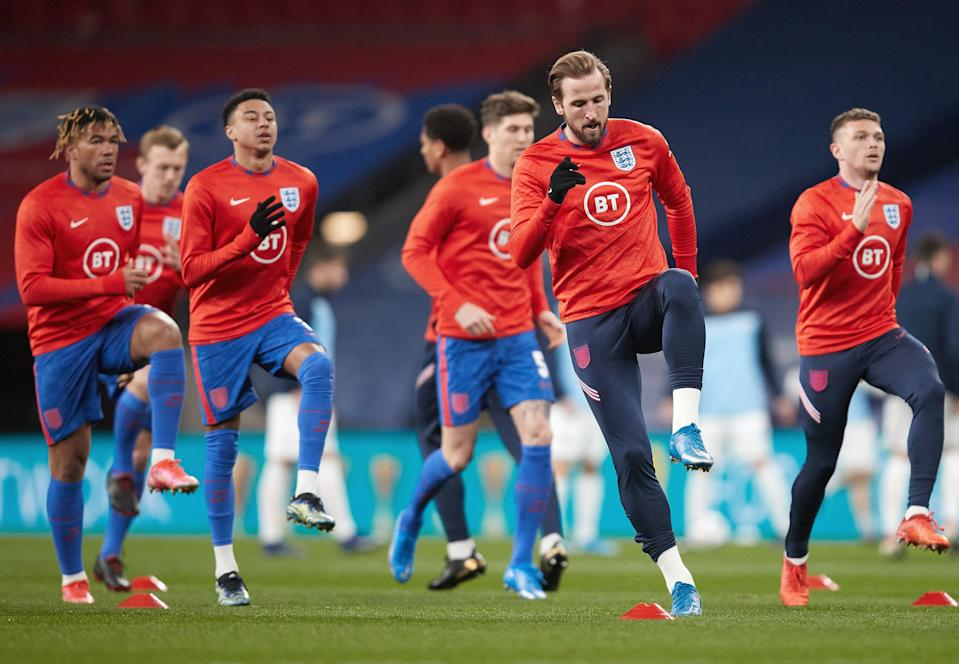 Harry Kane leads England during a warm-up (The FA via Getty Images)
