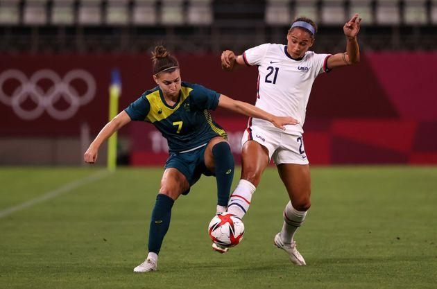 KASHIMA, JAPAN - JULY 27: Steph Catley of Australia battles for possession with Lynn Williams of the United States. (Photo: Atsushi Tomura via Getty Images)