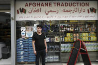 Afghanistan's Nassrullah Youssoufi poses at a grocery store in Paris, Friday, Sept. 10, 2021. Youssoufi started life in France in the streets after a harrowing journey out of Afghanistan that included three months in detention in Hungary for illegal entry. When not at his day job in the asylum court and his studies for a law degree, Youssoufi, who now has French nationality, holds court himself at the Afghan Market, a grocery store in northern Paris, where he helps Afghans in exile seeking guidance or translations of official documents. (AP Photo/Rafael Yaghobzadeh)