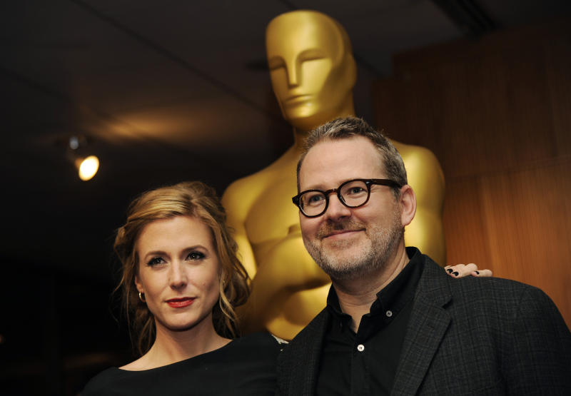 """Morgan Neville, right, director and co-producer of the Oscar-nominated documentary film """"20 Feet from Stardom,"""" and fellow co-producer Caitrin Rogers pose together at a reception featuring the Oscar nominees in the Documentary Feature and Documentary Short Subject categories on Wednesday, Feb. 26, 2014, in Beverly Hills, Calif. The Oscars will be held on Sunday at the Dolby Theatre in Los Angeles. (Photo by Chris Pizzello/Invision/AP)"""