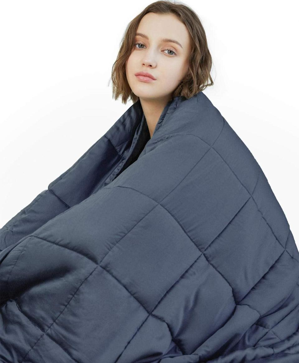 <p>Take a minute and relax with this <span>YnM Weighted Blanket</span> ($50).</p>