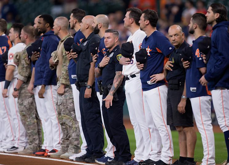 First responders stand with the Houston Astros during the national anthem at Minute Maid Park on Saturday. (Getty Images)