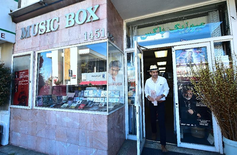 Iranian-American Arash Saedinia (R), an English literature professor and writer at UCLA, steps out of the Music Box on Westwood Boulevard in Los Angeles (AFP Photo/Frederic J. Brown)