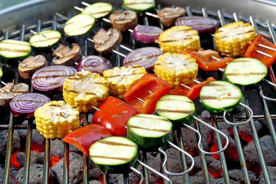 """<p>Embracing deliciously marinated and perfectly <a href=""""https://www.delish.com/uk/cooking/recipes/a33388598/veggie-kebabs/"""" rel=""""nofollow noopener"""" target=""""_blank"""" data-ylk=""""slk:grilled vegetable kebabs"""" class=""""link rapid-noclick-resp"""">grilled vegetable kebabs </a>will ensure every plant-based guest is happy. </p><p>You can put whatever you want on these - from red peppers and chillies to tofu and mushrooms. Use your favourite marinade on them, and the put them straight on the BBQ to char and cook through for 10 minutes.</p>"""