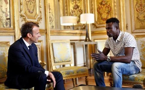 <span>Emmanuel Macron awarded Mamadou Gassama a special medal and diploma for bravery and devotion</span> <span>Credit: POOL </span>
