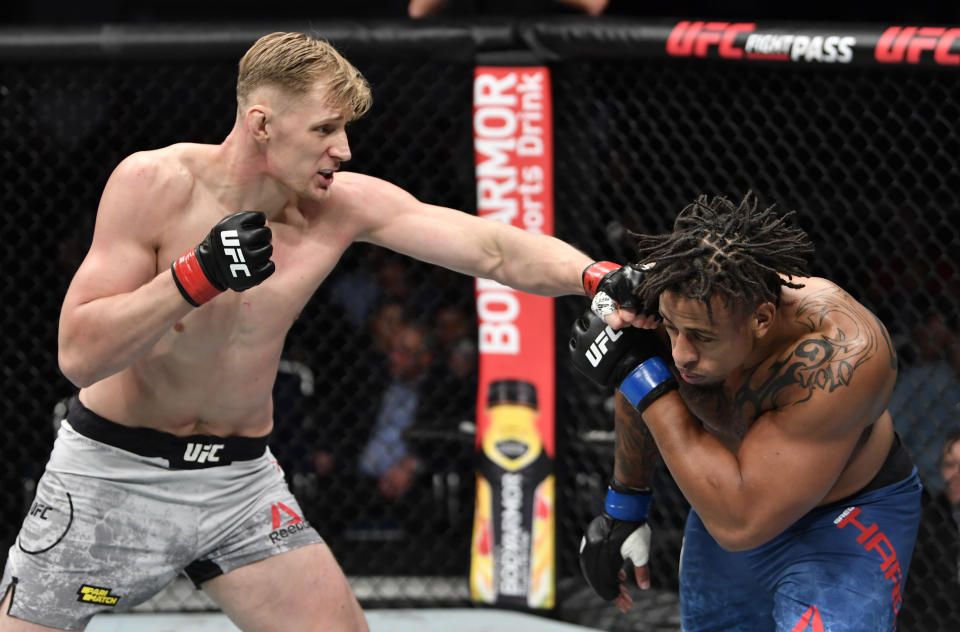 Alexander Volkov of Russia punches Greg Hardy in their heavyweight bout during the UFC Fight Night event at CSKA Arena on November 09, 2019 in Moscow, Russia. (Photo by Jeff Bottari/Zuffa LLC via Getty Images)
