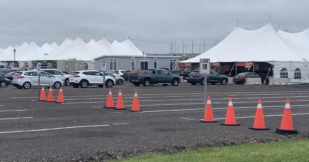 Vehicles go through the COVID-19 testing site as they arrive on P.E.I. Sunday morning. (Tony Davis/CBC - image credit)