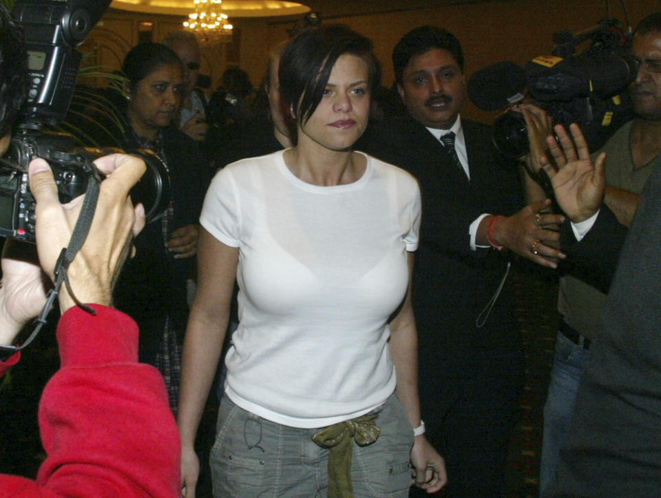 ** FILE ** In this Feb. 27, 2007 file photo, British television actress Jade Goody leaves a press conference in New Delhi, India. Goody, a brash British reality show star whose ups and downs captivated the nation is approaching her death the same way she has lived, on television. Given just months to live from cervical cancer that spread to her liver and bowels, 27-year-old Jade Goody sees no reason to turn the cameras off now. (AP Photo/Mustafa Quraishi, File)