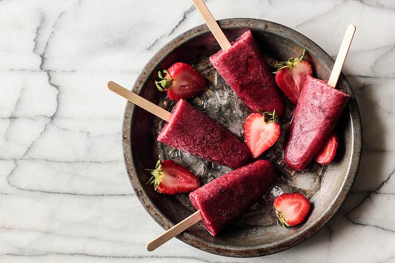 """<p>Wine lovers, take note. These sweet coolers will definitely brighten up any warm summer evening. Recipe <a rel=""""nofollow"""" href=""""http://www.pastryaffair.com/blog/roasted-strawberry-red-wine-popsicles.html"""">here</a>. </p>"""
