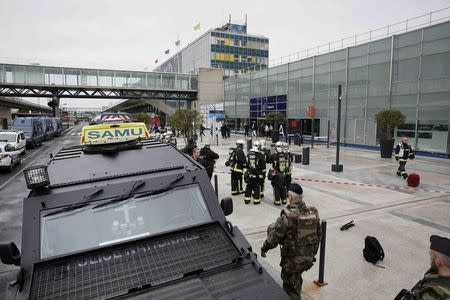 Military and emergency services outside Orly airport southern terminal after shooting incident near Paris