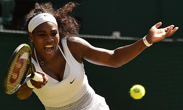 US player Serena Williams returns against Spain's Garbine Muguruza during the women's singles final at the 2015 Wimbledon Championships in London, on July 11, 2015 (AFP Photo/Leon Neal)