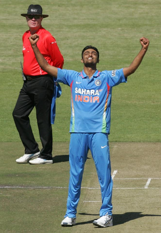 Indian bowler Shami Ahmed celebrates a wicket during the first of five ODI series match between India and Zimbabwe at the Harare Sports Club on 24 July, 2013. AFP PHOTO / JEKESAI NJIKIZANA        (Photo credit should read JEKESAI NJIKIZANA/AFP/Getty Images)