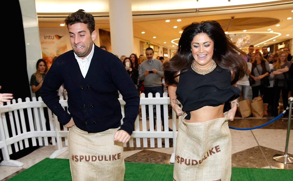 THURROCK, ENGLAND - NOVEMBER 22: James Argent from 'The Only Way Is Essex' and Casey Batchelor celebrate a new Spudulike opening by taking part in a tradional potato sack race at Lakeside Shopping Centre on November 22, 2014 in Thurrock, England. (Photo by Tim P. Whitby/Getty Images for Spudulike)