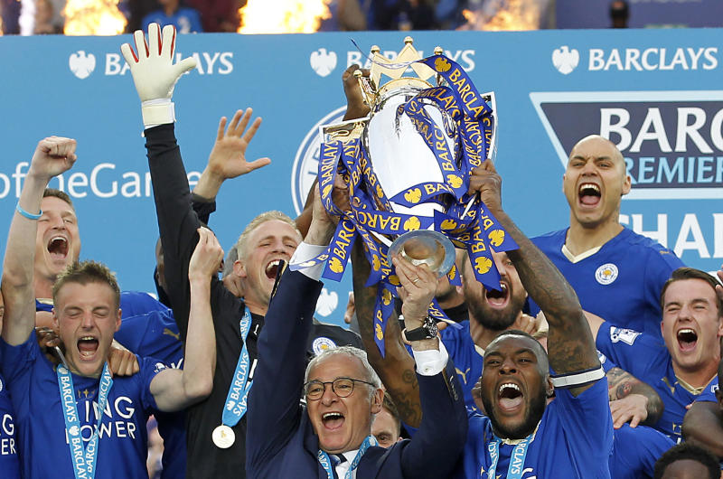 """Britain Soccer Football - Leicester City v Everton - Barclays Premier League - King Power Stadium - 7/5/16 Leicester City's Wes Morgan and manager Claudio Ranieri lift the trophy as they celebrate winning the Barclays Premier League Action Images via Reuters / John Clifton Livepic EDITORIAL USE ONLY. No use with unauthorized audio, video, data, fixture lists, club/league logos or """"live"""" services. Online in-match use limited to 45 images, no video emulation. No use in betting, games or single club/league/player publications. Please contact your account representative for further details."""