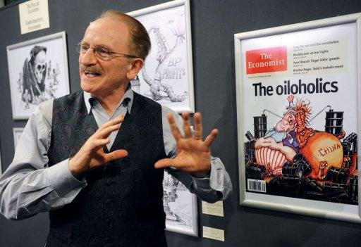 """American cartoonist Kevin KAL Kallaugher talks about his drawings during an exhibition at the National Museum of Contemporary Art in Bucharest. Political cartoons are """"on the frontline of freedom"""" as recent attacks on cartoonists in Iran and Syria showed, famous American cartoonist Kevin KAL Kallaugher told AFP in Bucharest"""