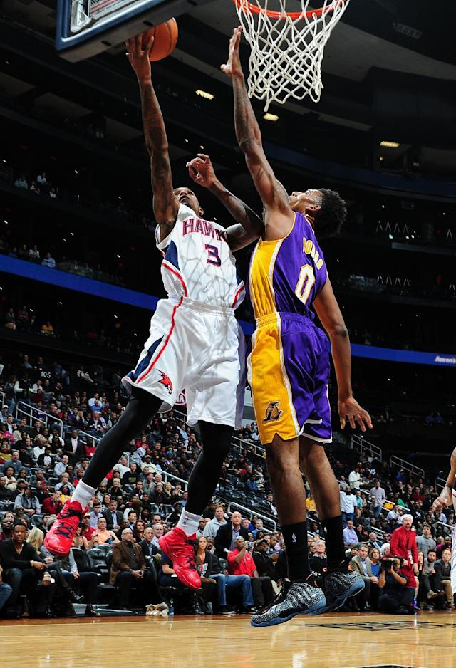 ATLANTA, GA - DECEMBER 16: Louis Williams #3 of the Atlanta Hawks goes up for the layup against the Los Angeles Lakers on December 16, 2013 at Philips Arena in Atlanta, Georgia. (Photo by Scott Cunningham/NBAE via Getty Images)
