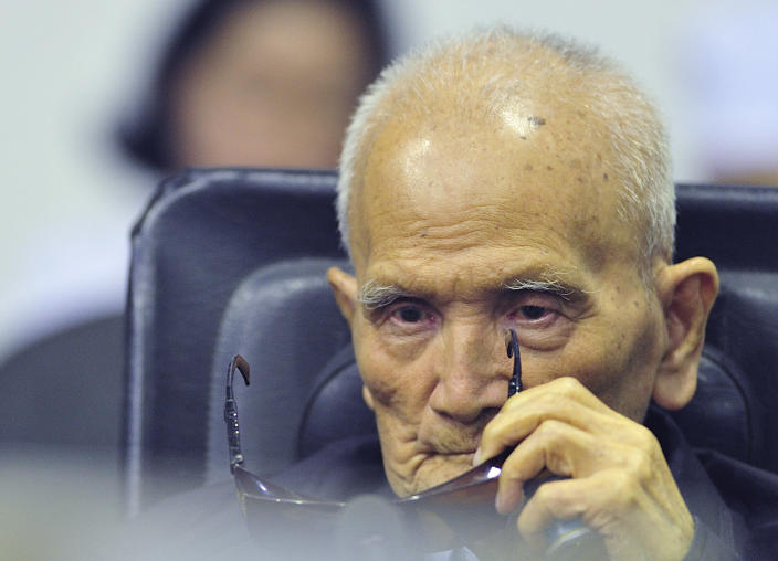 FILE - In this Nov. 16, 2018 file photo released by the Extraordinary Chambers in the Courts of Cambodia, Nuon Chea, who was the Khmer Rouge's chief ideologist and No. 2 leader, sits in a court room before a hearing at the U.N.-backed war crimes tribunal in Phnom Penh, Cambodia. Chea, the chief ideologue of the communist Khmer Rouge regime that destroyed a generation of Cambodians, died Sunday, Aug. 4, 2019, the country's U.N.-assisted genocide tribunal announced. He was 93. (Mark Peters/Extraordinary Chambers in the Courts of Cambodia via AP, File)
