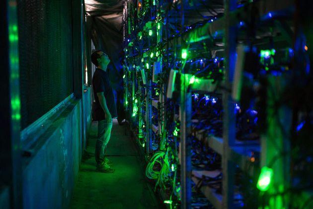 KONGYUXIANG, GARZE, SICHUAN, CHINA - AUGUST 12: Haobtc's bitcoin mine site manager, Guo-hua, checks mining equipment inside their bitcoin mine near Kongyuxiang, Sichuan, China. (Photo by Paul Ratje/For The Washington Post via Getty Images) (Photo: The Washington Post via Getty Images)