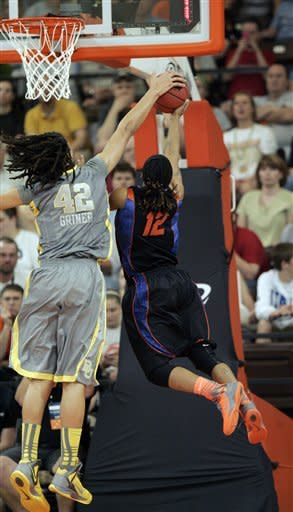 Baylor's Brittney Griner (42) blocks the shot of Florida's Deana Allen during the first half of a second-round NCAA college basketball tournament game, Tuesday, March 20, 2012, in Bowling Green, Ohio. (AP Photo/J.D. Pooley)