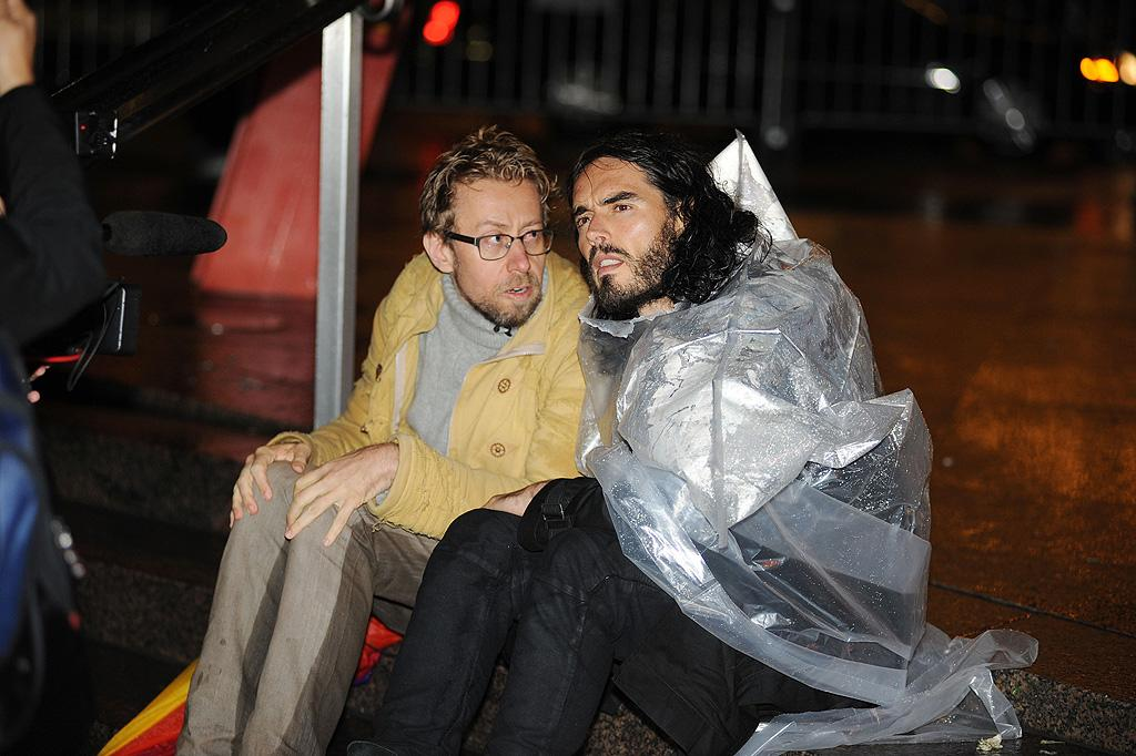Russell Brand braved the rain -- with the help of a very unstylish raincoat -- to join Occupy Wall Street protesters at New York City's Zuccotti Park on Wednesday. Alec Baldwin also joined the protest on the same night. (10/19/2011)