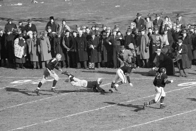 FILE - In this Dec. 14, 1941, file photo, Chicago Bears' Hugh Gallarneau (8) stumbles as a Green Bay Packers defender attempts a diving tackle during a football game in Chicago. The NFL's most ancient rivals open the league's 100th season in Chicago, Thursday, Sept. 5, 2019. (AP Photo/File)