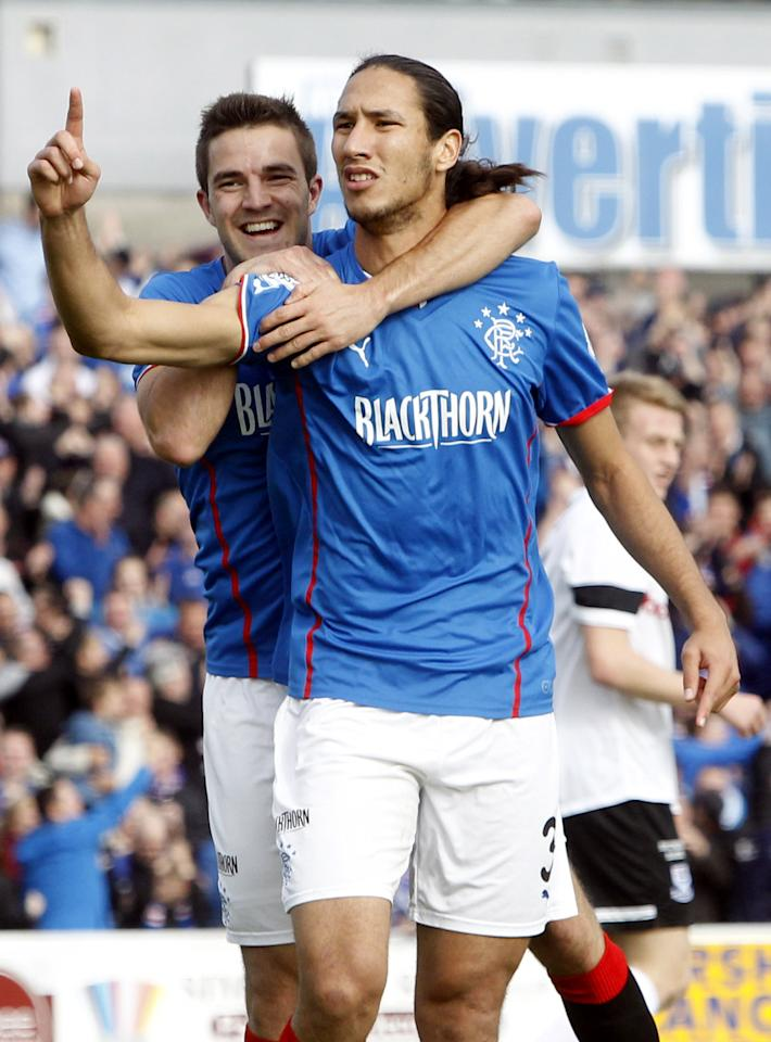 Rangers' Belil Mohsni celebrates his goal with team-mate Andrew Little during the Scottish League One match at Somerset Park, Ayr.