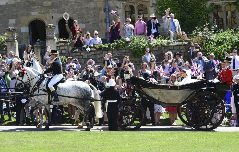 The crowd roared as Harry and Meghan emerged from St. George's Chapel.