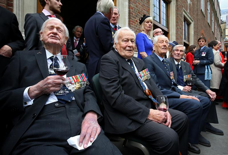 LONDON, ENGLAND - SEPTEMBER 17: Battle of Britain veterans (L-R) Wing Commander Tom Neil, Squadron Leader Geoffrey Wellum, Wing Commander Tim Elkington and Wing Commander Paul Farnes watch a flypast following a service marking the 77th anniversary of the Battle of Britain at Westminster Abbey on September 17, 2017 in London, England. The annual service remembers the pilots and aircrew of the Royal Air Force who lost their lives in the 1940 Battle of Britain during World War II. (Photo by Gareth Fuller - WPA Pool/Getty Images)
