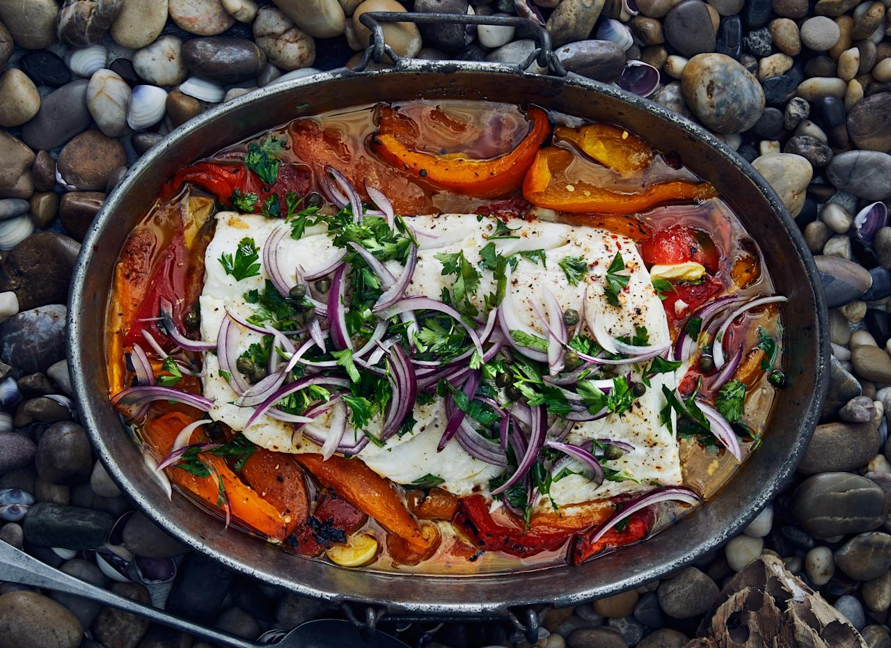 "For this slow-roasted cod recipe, if you get a fillet that includes the thin, tapered tail end of the cod, fold it underneath so the fillet will cook evenly. <a href=""https://www.bonappetit.com/recipe/slow-roasted-cod-with-bell-peppers-and-capers?mbid=synd_yahoo_rss"">See recipe.</a>"