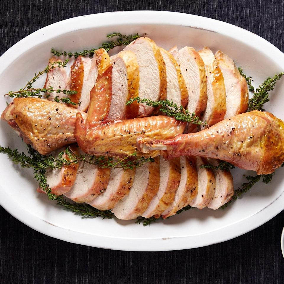 """A flattened bird roasts much more quickly. We love it brightened up with a tangy caper and mustard sauce. <a href=""""https://www.epicurious.com/recipes/food/views/quick-roasted-turkey-with-parsley-caper-sauce-51258420?mbid=synd_yahoo_rss"""" rel=""""nofollow noopener"""" target=""""_blank"""" data-ylk=""""slk:See recipe."""" class=""""link rapid-noclick-resp"""">See recipe.</a>"""