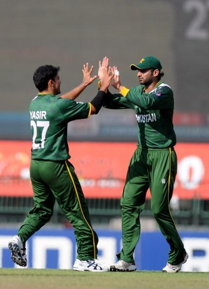 COLOMBO, SRI LANKA - SEPTEMBER 28:  Yasin Arafat of Paksitan (L) celebrates the wicket of  Jacques Kallis of South Africa with teammate Shoaib Malik during the Super Eight match between Pakistan and South Africa at R. Premadasa Stadium on September 28, 2012 in Colombo, Sri Lanka.  (Photo by Pal Pillai/Getty Images)