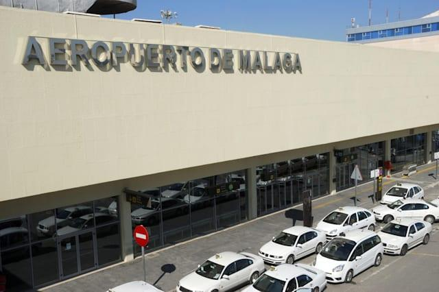 Exterior of airport of Malaga in Spain with taxicabs waiting outside.
