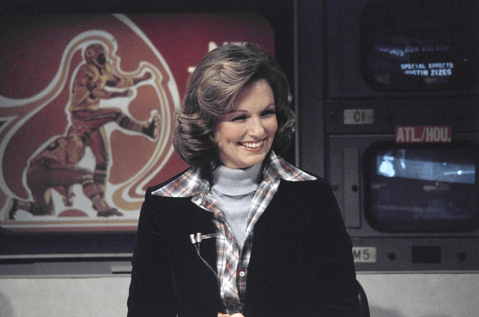 "FILE - In this Nov. 28, 1976, file photo, CBS sportscaster Phyllis George is seen in New York. Sports in 2020 was an unending state of mourning. It was as if every week, sometimes days, another luminary fell, bringing a cascade of condolence and remembrance. In the broadcast studio, there was Phyllis George. She put aside her Miss America tiara to become a sportscaster, opening doors for women with her work on CBS's ""The NFL Today."" (AP Photo/Suzanne Vlamis, File)"