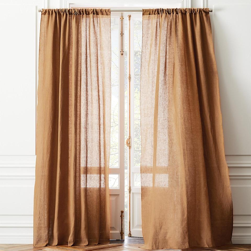 """<p>Sick of beige but want to keep a neutral hue? Check out this copper set. And if they don't come in the size you need, no need to worry: These curtains can be easily hemmed and come with instructions to <a href=""""https://www.marthastewart.com/1543232/no-sew-blackout-curtains"""" rel=""""nofollow noopener"""" target=""""_blank"""" data-ylk=""""slk:shorten them to fit your space"""" class=""""link rapid-noclick-resp"""">shorten them to fit your space</a>.</p> <p><strong><em>Shop Now:</em> </strong><em>CB2 Linen Copper Curtain Panel, $59.95, </em><a href=""""https://www.cb2.com/linen-copper-curtain-panel-48x84/s459091"""" rel=""""nofollow noopener"""" target=""""_blank"""" data-ylk=""""slk:cb2.com"""" class=""""link rapid-noclick-resp""""><em>cb2.com</em></a><em>. </em></p>"""